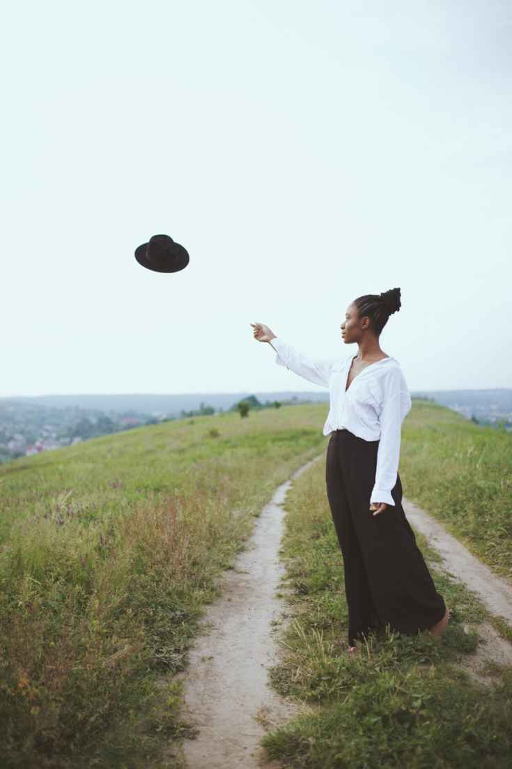photo of woman throwing her hat